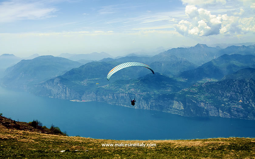 Paraglider taking off from Monte Baldo on Lake Garda